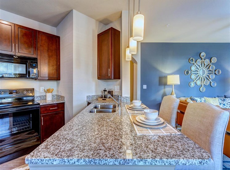 Fully Equipped Gourmet Kitchen and Pantry, with Breakfast Bar and Custom Backsplash at Creekside at Providence Apartments, Mt. Juliet, TN 37122
