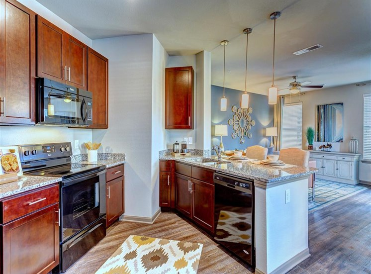 Gorgeous Kitchens Complete with Designer Finishes, Modern Appliances and Granite Countertops Creekside at Providence Apartments, Mt. Juliet, TN 37122