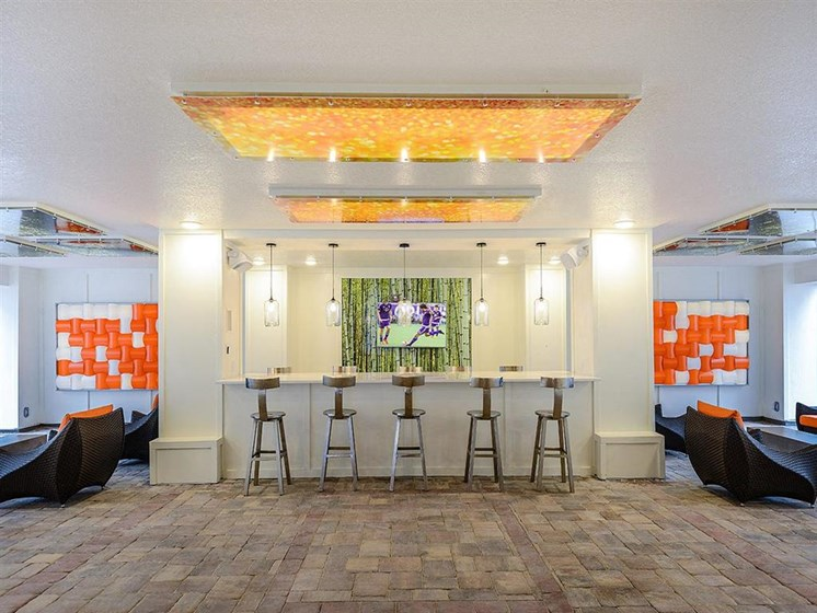 Clubhouse Bar with Flat Screen TV for Resident Entertainment Use at EOS Apartments, Orlando, FL 32826