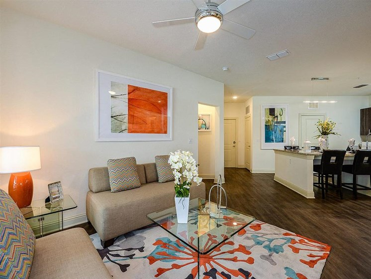 Open Floor Plan Living Rooms with Wood Plank Vinyl Flooring (in Select Units) and Vaulted Ceilings at EOS Apartments, Orlando, FL 32826