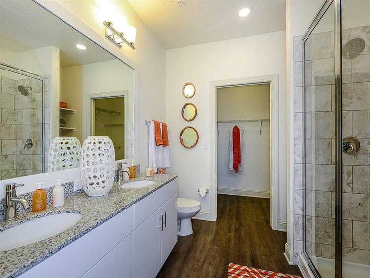 Relax after a long day in your bathroom with garden tub, granite countertops and walk-in showers at EOS Apartments, Orlando, FL 32826