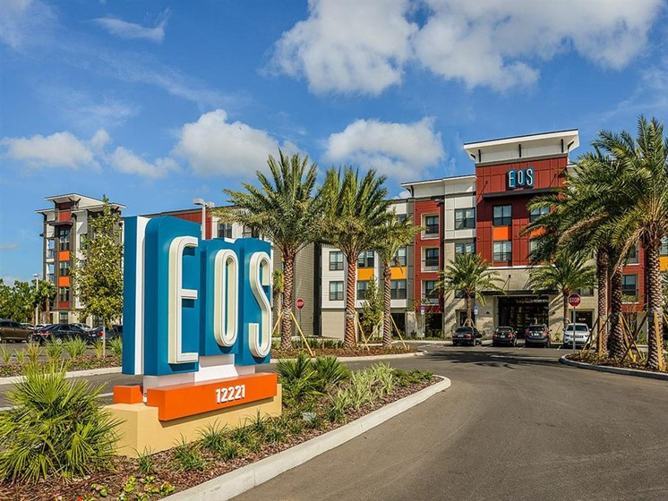 Lush landscaping surrounds you as you drive into EOS Apartments, Orlando, FL 32826