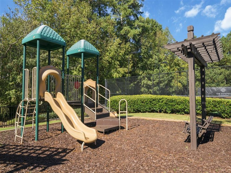 Children have a place to run and play at Estates at Crossroads too! Slides, Climbing Equipment and Bike Parking at Estates at Crossroads, Duluth, GA 30096