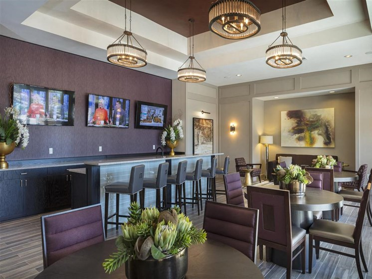 Stunning Modern Community Clubhouse with Ample Space and Multiple TV Screens for Meetings & Viewing Parties at Greenwood Reserve Apartments, Lenexa, KS 66215