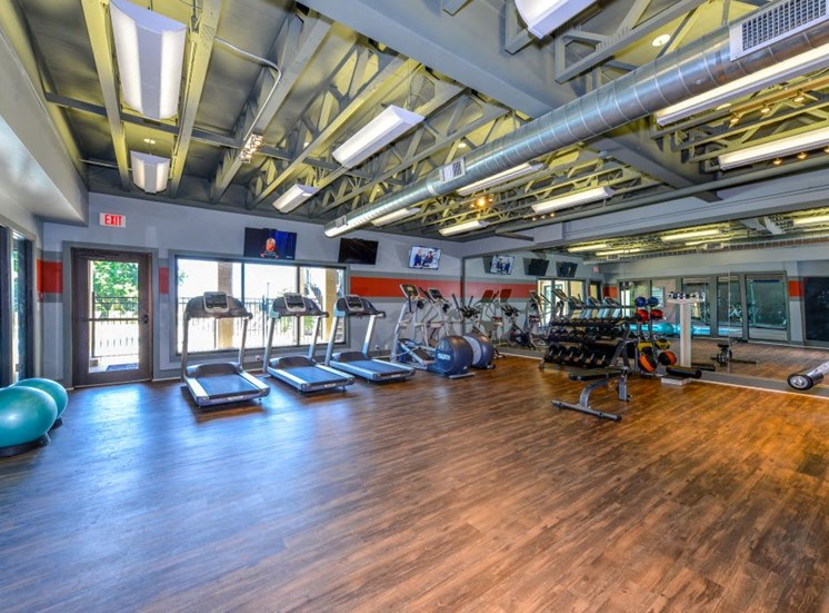 24 Hour Health and Fitness Club including TVs and Cardio and Weight Training at Hampton Woods Apartments, Shawnee, KS 66217