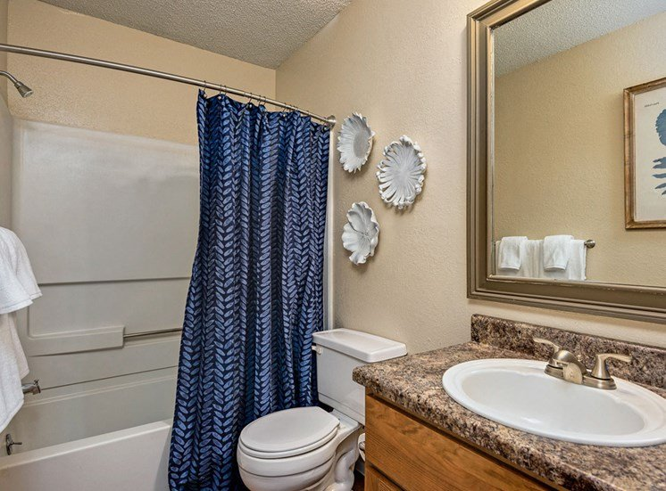 Relax after a long day in your bathroom with garden tub, new countertops, updated lighting and more at Hampton Woods Apartments, Shawnee, KS 66217