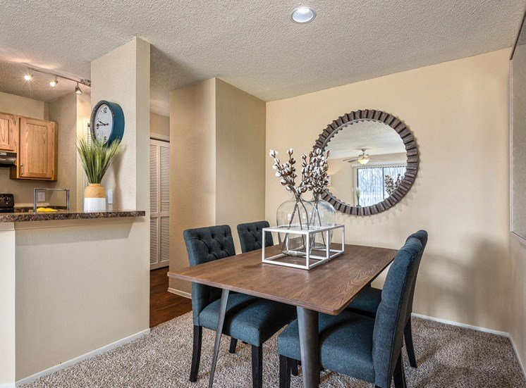 Extra Space for Dining Area with Wood Plank Flooring and Breakfast Bar Seating as Well at Hampton Woods Apartments, Shawnee, KS 66217