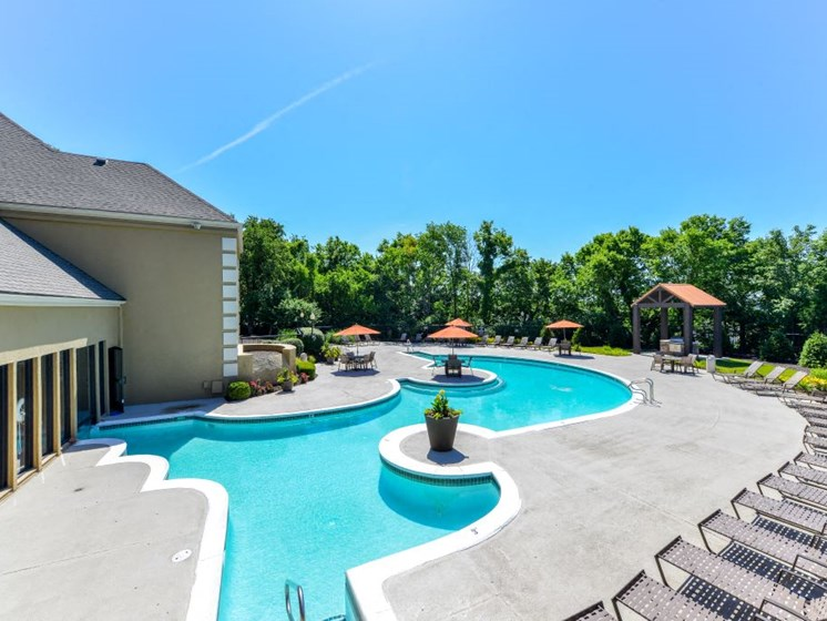 Refreshing Swimming Pool with Relaxing Poolside Lounge Chairs at Hampton Woods Apartments, Shawnee, KS 66217