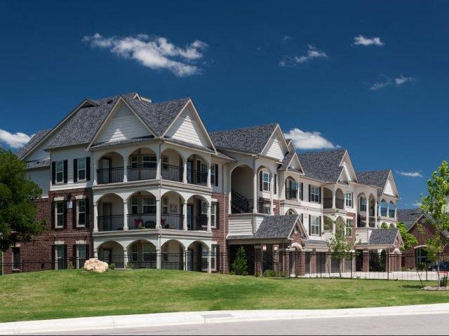 Lush landscaping surrounds you as you drive into Lone Oak Apartments, Round Rock, TX 78665