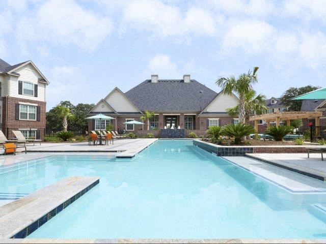 Refreshing Swimming Pool with Tanning Ledges at Lone Oak Apartments, Round Rock, TX 78665