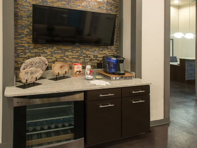 Complimentary Water and Coffee Bar in our Stunning Modern Design Community Clubhouse with Ample Space and Amenities at Moretti at Vulcan Park Apartment Homes, Homewood, AL 35209