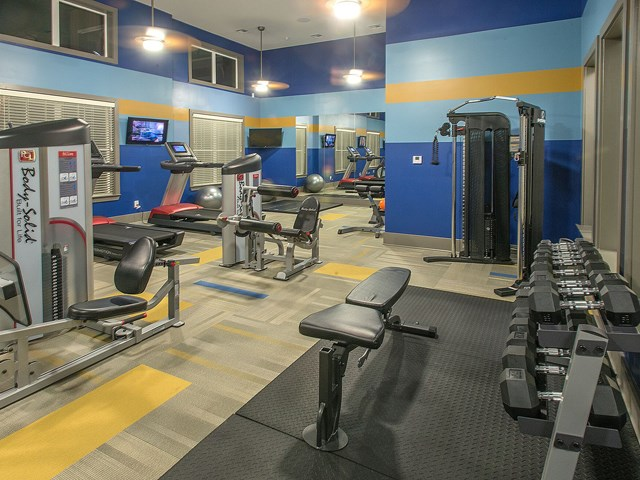 24 Hour Fitness Gym with Weight Training, Cardio Machines and Flat Screen TVs to Enjoy during your Workout at Moretti at Vulcan Park Apartment Homes, Homewood, AL 35209