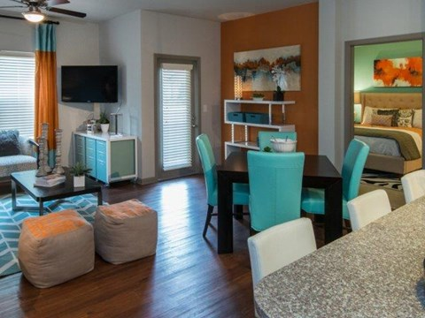 Gorgeous Dining Room Space with Modern Lighting and Wood Plank Vinyl Flooring at Moretti at Vulcan Park Apartment Homes, Homewood, AL 35209