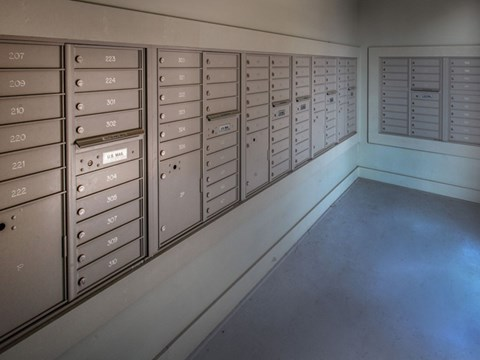 Indoor Mail Room with Mailboxes for Residents at Moretti at Vulcan Park Apartment Homes, Homewood, AL 35209