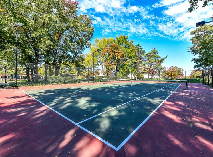 Enjoy Outdoor Games and Variety of Activities on our Multi-Purpose Sports Court Pointe Royal Townhome Apartments, Overland Park, KS 66213