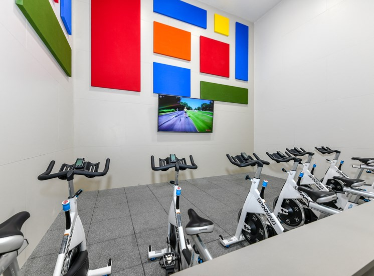Health and Fitness Club including Spin Studio with Flat Screen TVs and more at Pointe Royal Townhome Apartments, Overland Park, KS 66213