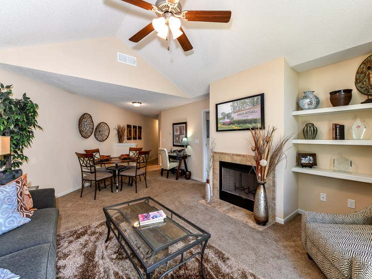 Gorgeous Modern Living Room with Elegant Crown Moulding and Wood Burning Fireplaces (in Select Units) at Pointe Royal Townhome Apartments, Overland Park, KS 66213