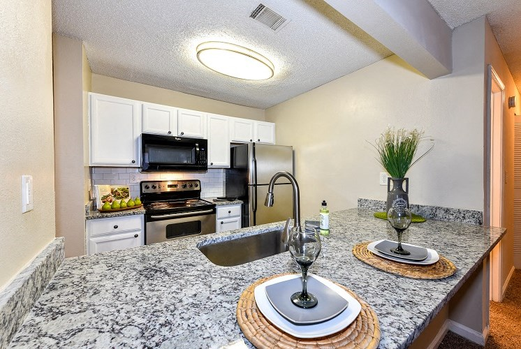 Kitchen with Granite at Station Heights Apartments in Alpharetta, GA