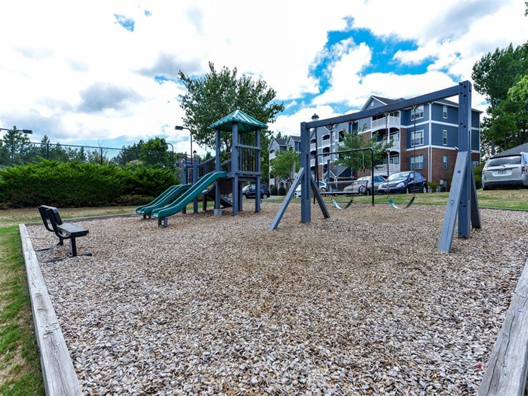 Children have a place to run at Sugarloaf Crossing too! Slides, Climbing Equipment and Bike Parking at Sugarloaf Crossing Apartments, Lawrenceville, GA 30046