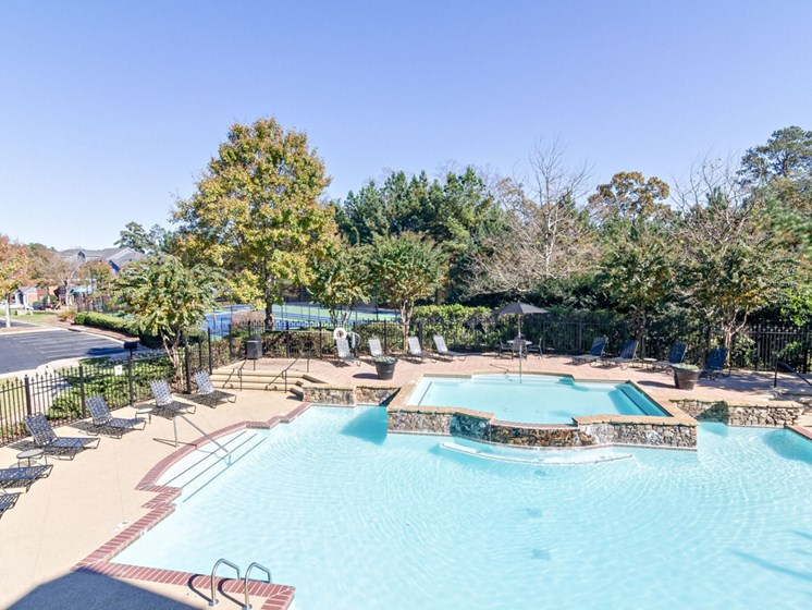 Resort Style Pool with Soothing Waterfall Features and Sundeck with Poolside Wi-Fi Access at Sugarloaf Crossing Apartments, Lawrenceville, GA 30046
