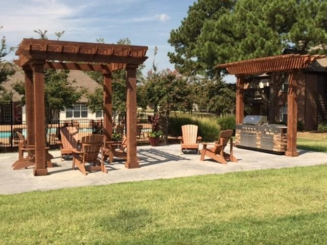Enjoy a nice BBQ meal with our Outdoor Grill and Pergola Covered Lounge Area at The Addison at Collierville Apartments, Collierville, TN 38017