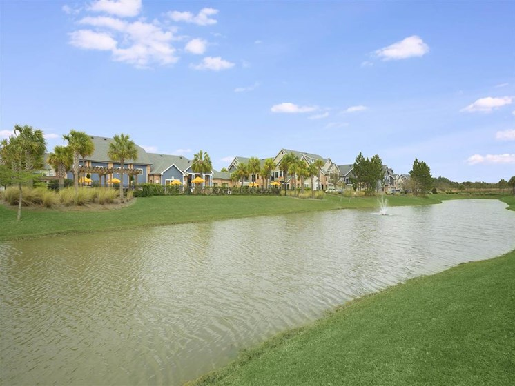 Water Features Throughout Community with a Stocked Fishing Lake and Beautifully Landscaped Grounds at The Arlington at Eastern Shore Apartments, Spanish Fort, AL 36527