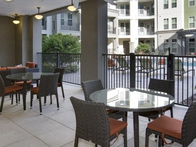 Outdoor Patio and Refreshing Pool and Lounge Seating at The Ivy Residences at Health Village, Orlando, FL 32804