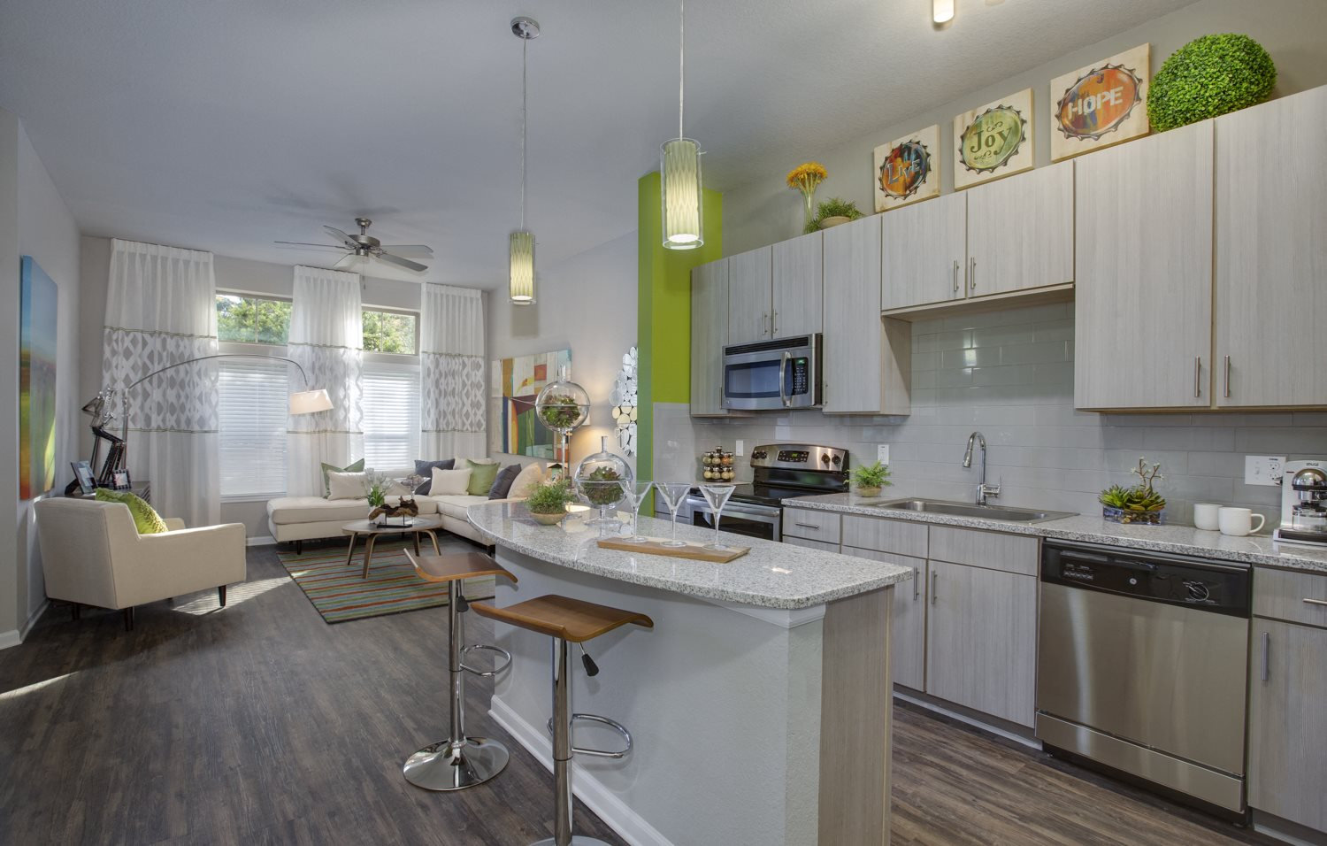 Open Floor Plan Kitchen with Wood Plank Vinyl Flooring (in Select Units) at The Ivy Residences at Health Village, Orlando, FL 32804