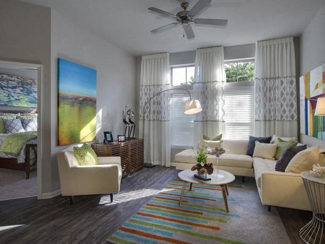 Open Floor Plan Living Rooms with Wood Plank Vinyl Flooring (in Select Units) and Vaulted Ceilings at The Ivy Residences at Health Village, Orlando, FL 32804