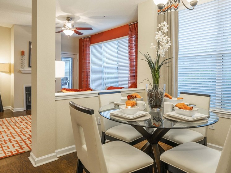 Gorgeous Dining Room Space with Elegant Lighting and Wood Plank Vinyl Flooring at The Lexington Apartments, Nashville, TN 37209