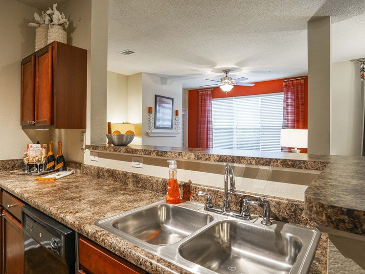 Newly Designed Kitchens with Goose Neck Faucets and Gas Stoves at The Lexington Apartments, Nashville, TN 37209