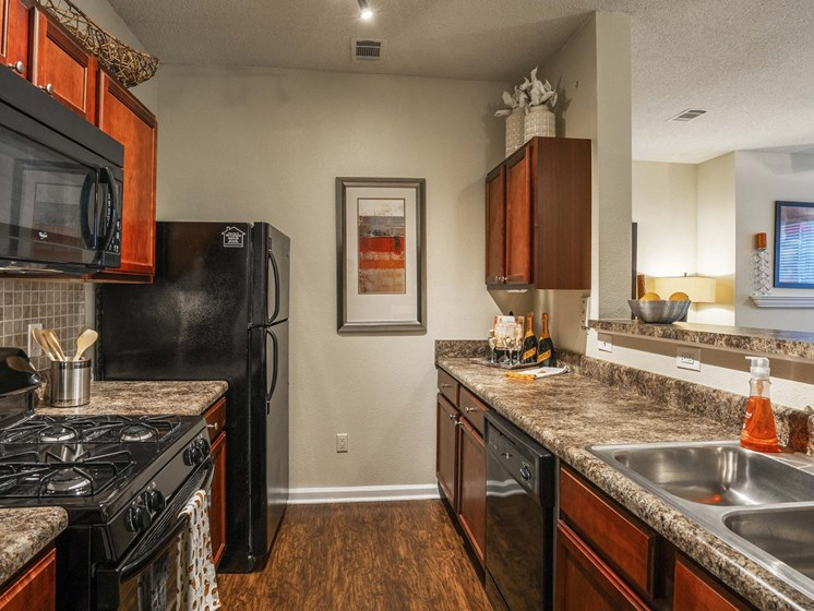Newly Designed Kitchens with Black Appliances and Built in Microwaves at The Lexington Apartments, Nashville, TN 37209