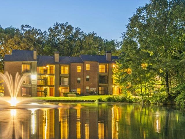 Meticulously maintained grounds with mature trees surround the gorgeous lakes and beautiful landscaping at The Summit Apartments, Memphis, TN 38128
