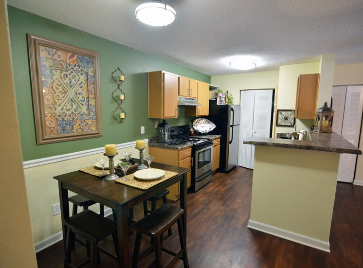 Upgraded Kitchens with New Countertops, Cabinetry and Appliances. Complete with a Bar Height Counter and Extra Dining Room Space at The Summit Apartments, Memphis, TN 38128
