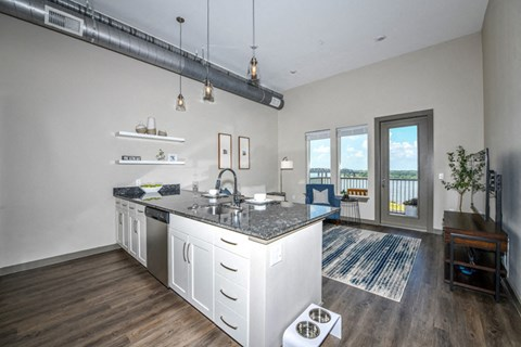 Wide open floorpans with stunning views, soaring ceilings, upscale wood style flooring, designer lighting and more make life comfortable at The Tennessee Brewery, Memphis, TN 38103