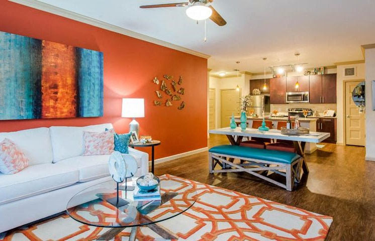 Gorgeous Modern Living Room with Vaulted Ceilings and Wood Plank Vinyl Flooring (in Select Units) at Twenty25 Barrett Apartments, Kennesaw, GA 30144