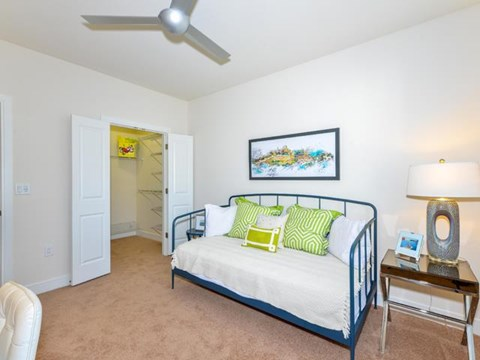 Bedroom with Large Walk-In Closet and Ceilings Fans at Vanguard Crossing Apartments, University City, MO 63124