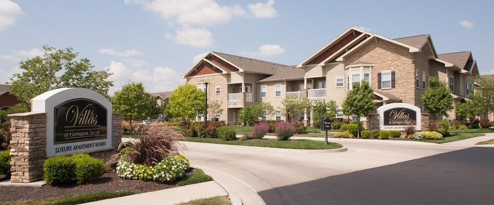 Expertly designed lush landscaping surrounds you as you drive into Villas at Carrington Square Apartments, Overland Park, KS 66221
