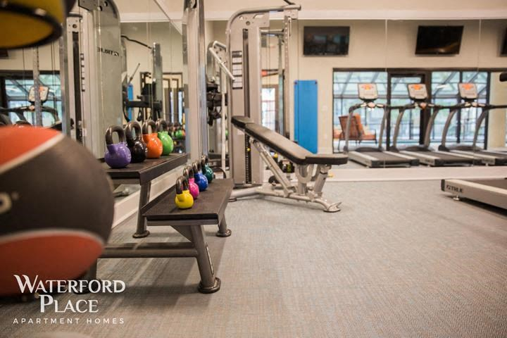 Results Oriented Fitness Center with Cardio Equipment, Flat Screen TV, Weight Training and more at Waterford Place Apartments, Louisville, KY 40207