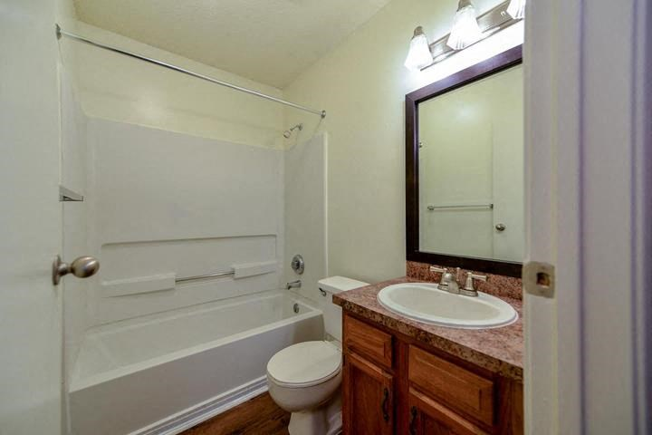 Spacious Bathroom with Relaxing Tub and Wood Laminate Flooring at Waterford Place Apartments, Louisville, KY 40207