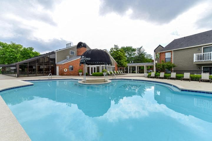 Lake Side Outdoor Swimming Pool with Lounge Chairs at Waterford Place Apartments, Louisville, KY 40207