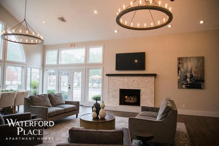 Luxurious Clubhouse with Cozy Seating Areas, Expertly Designed for Resident Use and Entertaining at Waterford Place Apartments, Louisville, KY 40207
