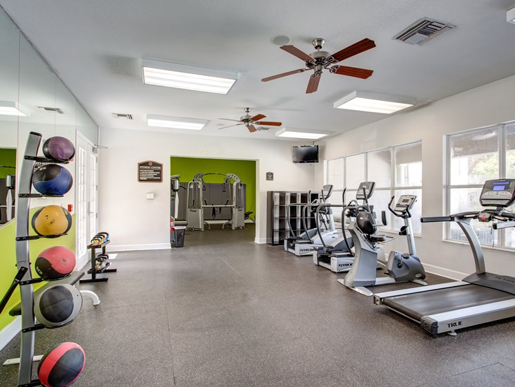 24 Hour Fitness Gym with Weight Training, Cardio Machines and Flat Screen TVs to Enjoy during your Workout at Westlake Apartment Homes, Sanford, FL 32771