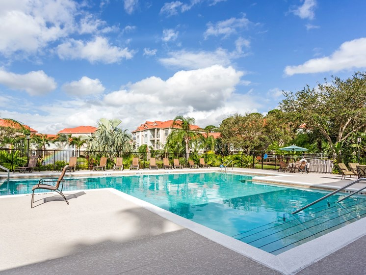 Enjoy our Two Refreshing Swimming Pools with Relaxing Poolside Lounge Chairs at Westlake Apartment Homes, Sanford, FL 32771
