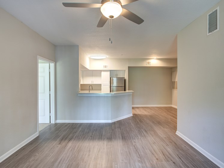 Newly Renovated Kitchens with White Counters and Sleek Black and Stainless Steel Appliances and Gorgeous Countertops at Westlake Apartment Homes, Sanford, FL 32771