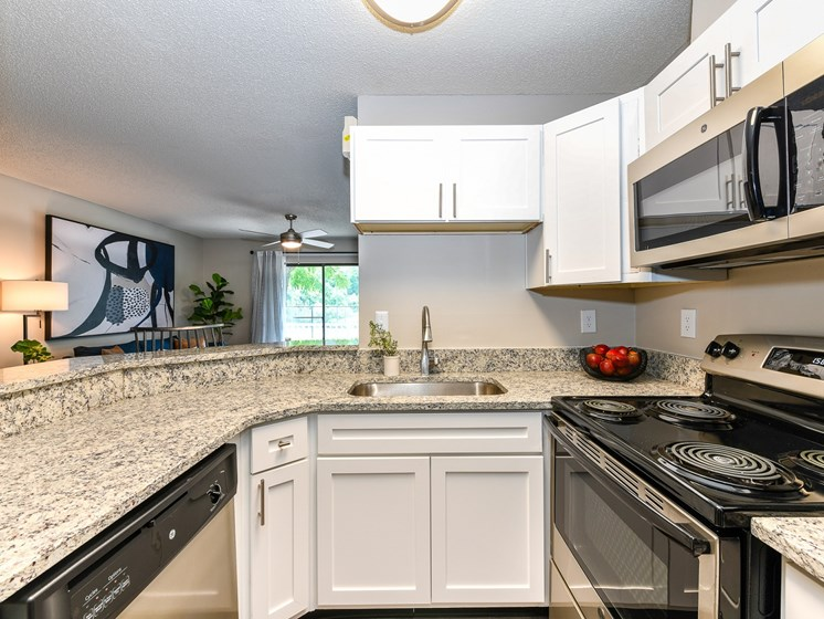 Kitchen with granite countertops and stainless steel appliances at 15Seventy, Chesterfield, MO 63017