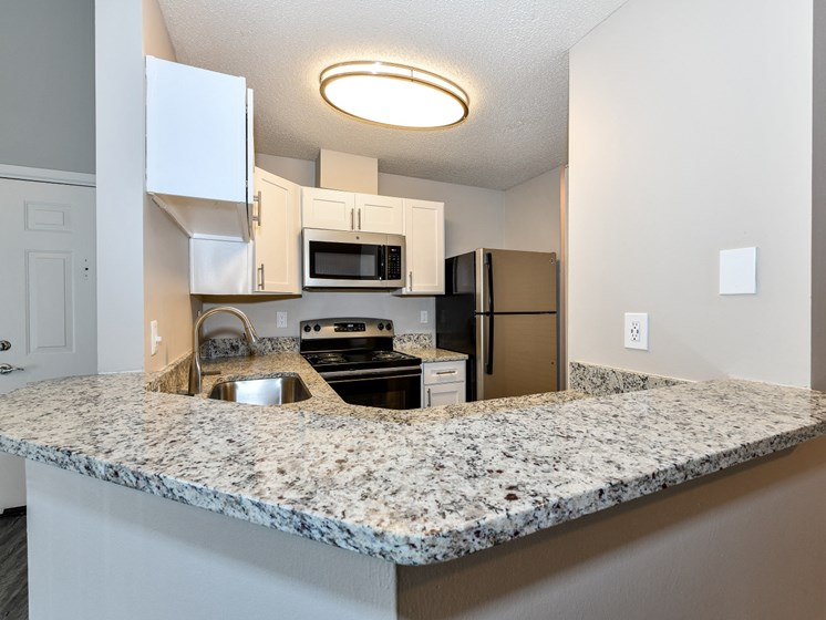 Upgraded Units Available with Sleek Black Appliances, Vinyl Plank Wood Flooring and Granite Like Countertops at 15Seventy Chesterfield Apartment Homes, Chesterfield, MO 63017