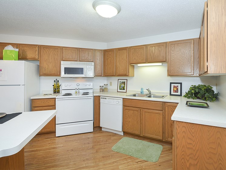 Fully-Equipped Kitchen with White Appliances and Wood Cabinets