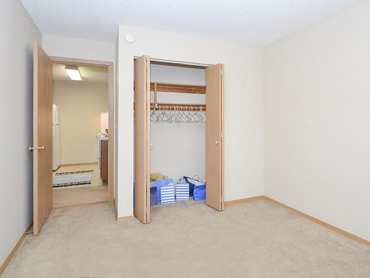 Bedroom with Sliding Wood Style Closet Doors