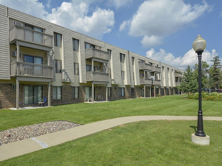Exterior Patios and Balconies Overlooking the Grass and Landscaping